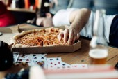 Fotografie selective focus of tasty pizza with man lying on background