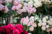 Fotografie variety of colorful blooming roses and tulips