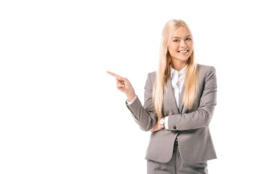 attractive blonde businesswoman smiling and showing something isolated on white