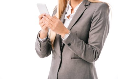 Cropped view of businesswoman using smartphone isolated on white stock vector