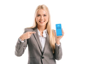 smiling businesswoman pointing at smartphone with skype app, isolated on white