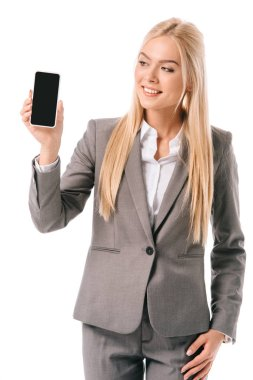 Smiling businesswoman showing smartphone with blank screen, isolated on white stock vector