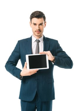 Handsome businessman holding digital tablet with blank screen isolated on white stock vector