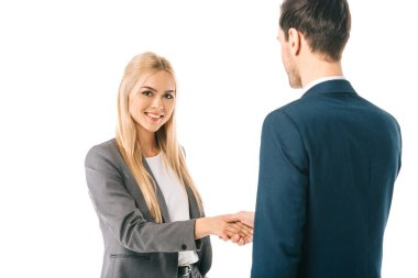 blonde businesswoman shaking hands with colleague and making deal isolated on white