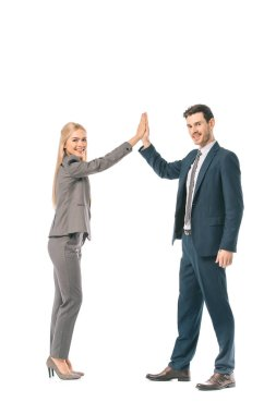 smiling successful business coworkers giving highfive isolated on white