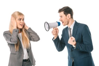 emotional businessman shouting with megaphone at frightened female colleague isolated on white