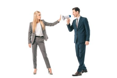 male boss shouting into megaphone at businesswoman who showing stop gesture isolated on white, gender equality concept