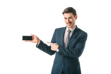Smiling businessman pointing at blank screen on smartphone, isolated on white stock vector