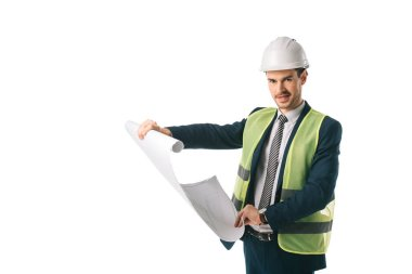 male engineer in helmet and safety vest holding blueprint, isolated on white