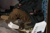 Fotografie partial view of homeless beggar man getting out coins from pocket