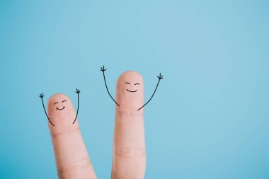 cropped view of happy excited fingers isolated on blue