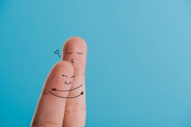 cropped view of happy couple of fingers hugging isolated on blue
