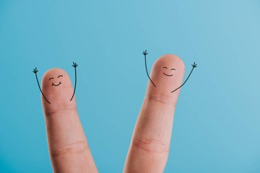 cropped view of excited smiling fingers isolated on blue