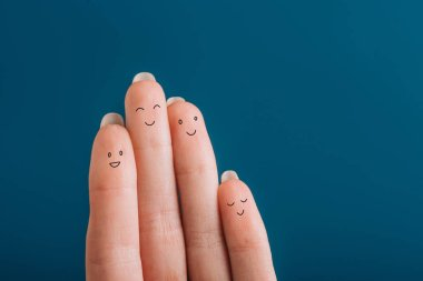 cropped view of happy human fingers isolated on blue