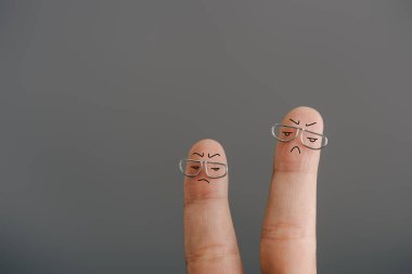 Cropped view of dissatisfied fingers in glasses isolated on grey stock vector