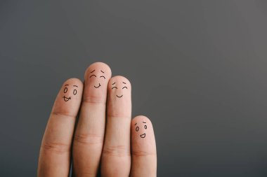 cropped view of happy human fingers isolated on grey