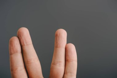 cropped view of human fingers isolated on grey
