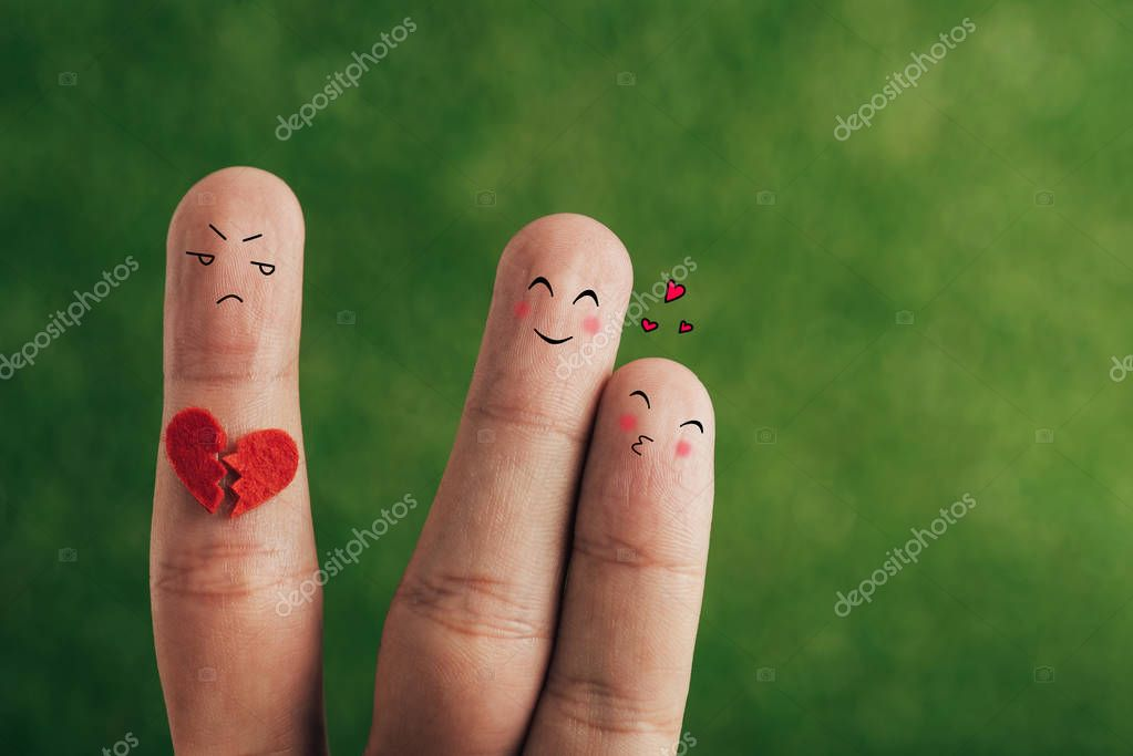 Cropped view of fingers as happy couple in love and third wheel with broken heart on green stock vector