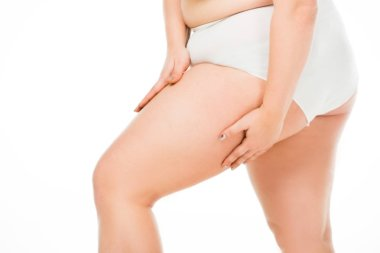 cropped view of overweight woman posing with hands on leg isolated on white, body positivity concept