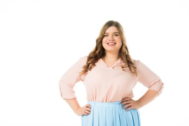 smiling happy plus size woman posing with hands on hips isolated on white