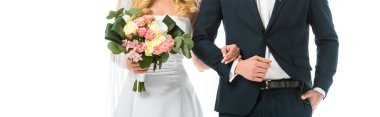 cropped view of bride with wedding bouquet, and groom in black suit isolated on white