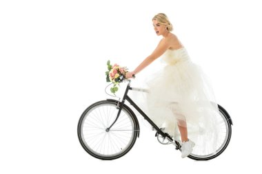 beautiful groom riding bicycle in wedding dress and sneakers isolated on white