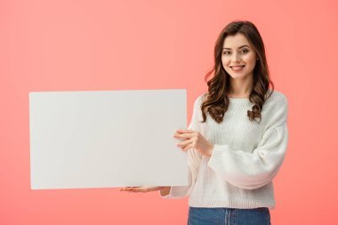 Smiling and beautiful woman holding blank placard with copy space isolated on pink stock vector