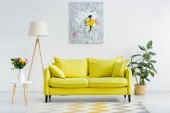 interior of modern white living room with decor and bright yellow sofa