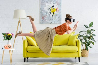 side view of elegant young woman flying in air while wearing virtual reality headset