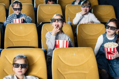 Multicultural friends watching movie in cinema and eating popcorn stock vector
