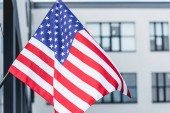 national american flag with stars and stripes near building