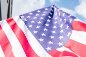 low angle view of stars and stripes on national flag of america