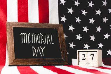 Memorial day lettering on chalkboard near cubes with date and flag of america with stars and stripes stock vector