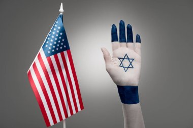 Cropped view of female hand with star of david near american flag on grey stock vector