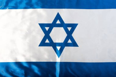 Close up of national israel flag with blue star of david stock vector
