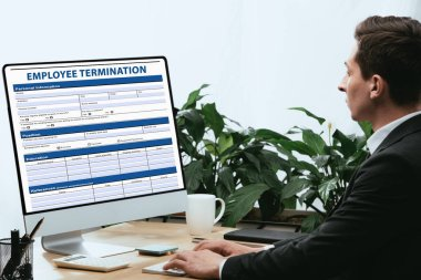 Man in suit filling in Employee Termination Form, Contract Concept stock vector