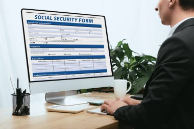 Cropped view of man filling in Social Security Form Application Concept stock vector