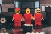 lego figurines of mechanics in red with various face expressions