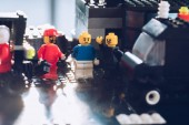 lego minifigures working at service station with sunlight
