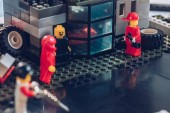 lego minifigures with tools working at service station