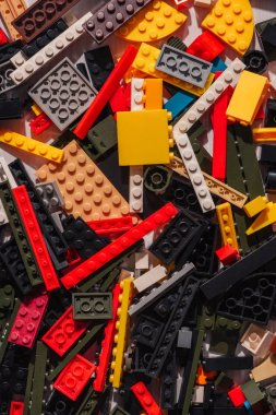 top view of colorful scattered plastic lego blocks