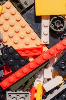 close up view of colorful scattered plastic lego blocks