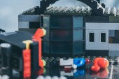 Selective Focus of Building made of black lego blocks