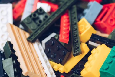 selective focus of colorful scattered plastic lego blocks