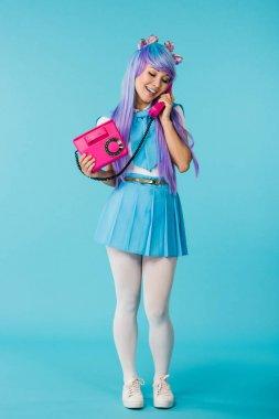 Full length view of asian anime girl talking on telephone on blue stock vector