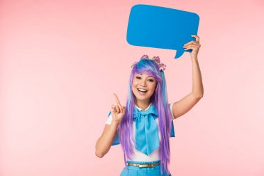Asian anime girl holding speech bubble and showing idea sign on pink