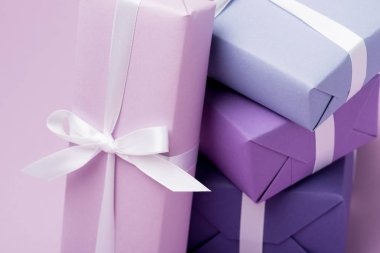 Colorful gift boxes with white ribbons on purple stock vector