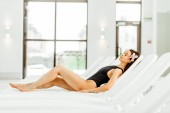 Fotografie pretty young woman lying on sunbed in spa center