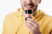cropped view of man holding container with youtube logo isolated on white