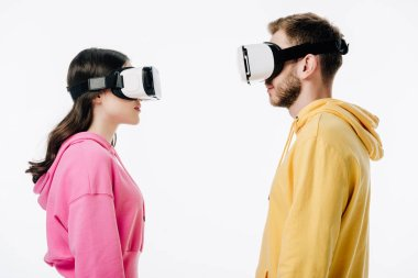 Side view of young man and woman using virtual reality headsets isolated on white stock vector